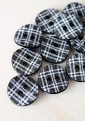 Bouton à carreaux gris
