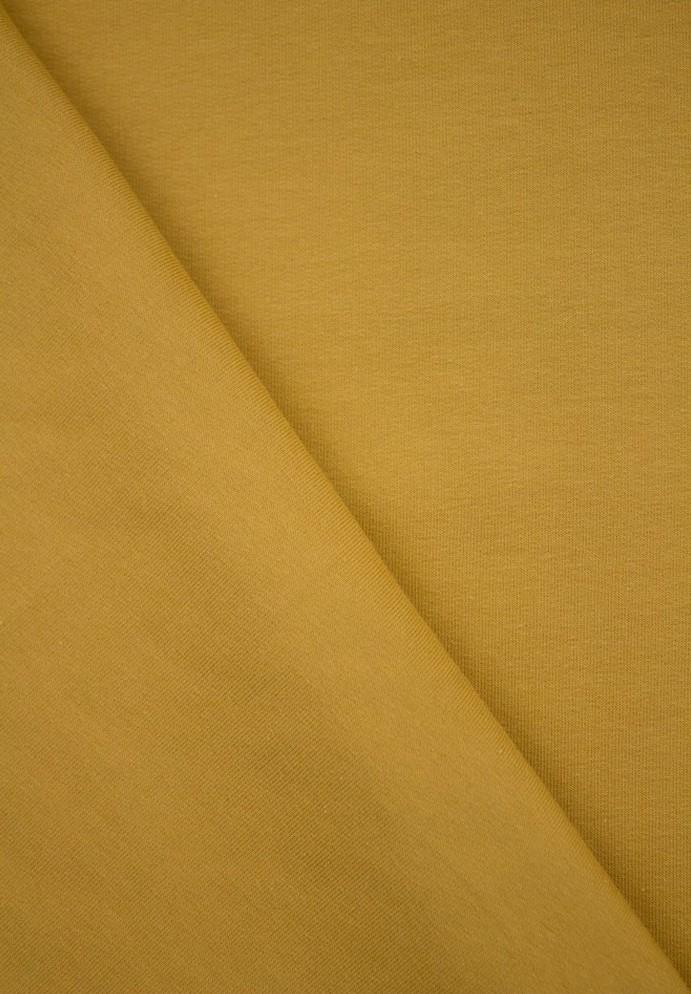 Tissu molleton de couleur jaune moutarde pour coudre un sweat