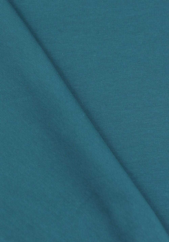 Tissu molleton de couleur bleu pétrole idéal pour coudre un sweat